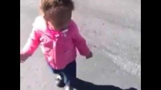 Cute baby girl is afraid of her own shadow